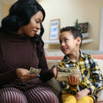 Woman with son handling money